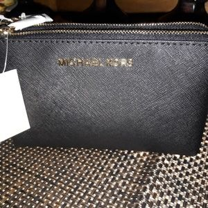 Micheal kors wristlet new with tags $65.00